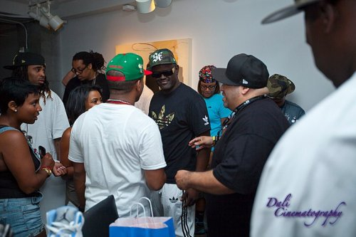 DJ Greg Street and Mayor talk with other sneaker friends.