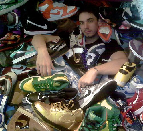 DJ AM in a pile of Nike Dunks