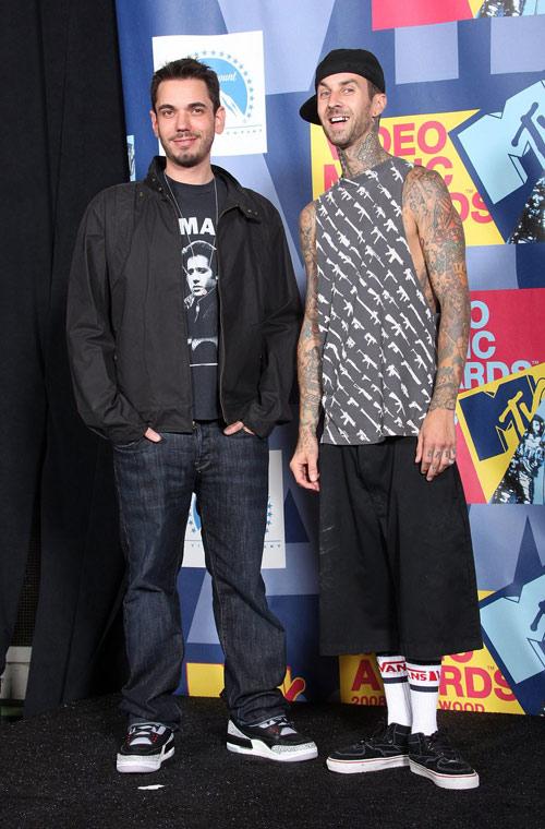 DJ AM in Air Jordan 3 with Travis Barker in Half Cabs