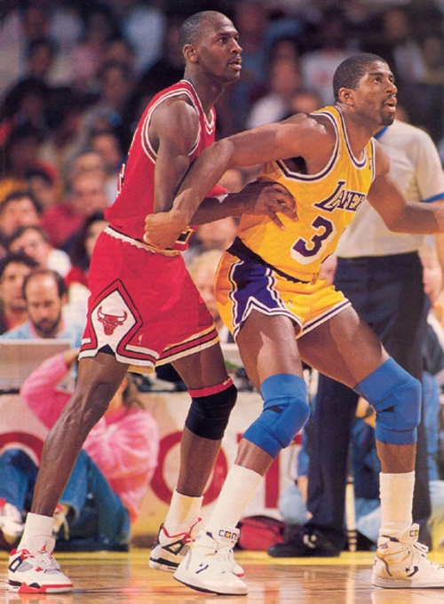 Michael Jordan defending Magic Johnson pic courtesy of SneakerFiles.